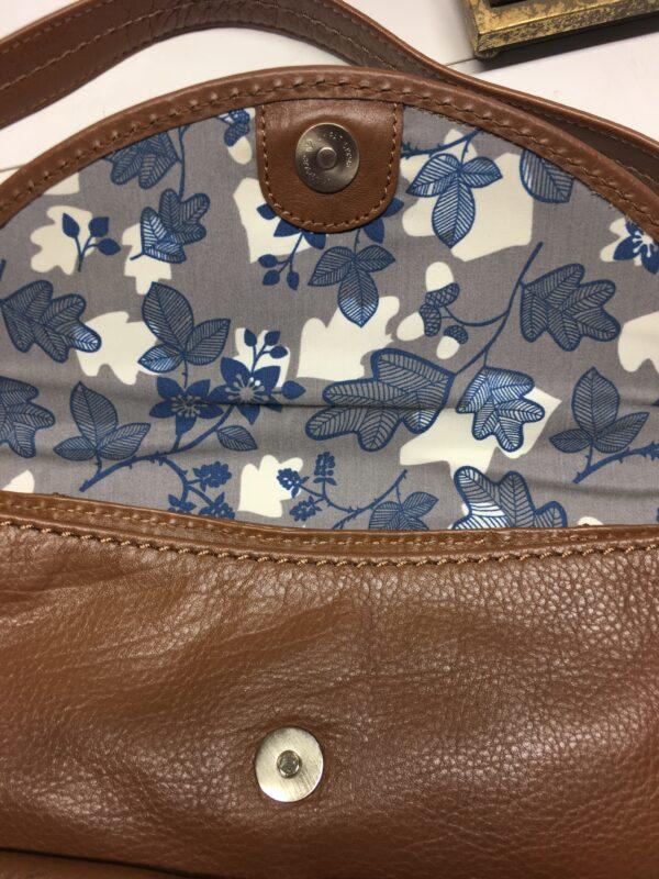 Blue & grey floral print fabric lining of tan Radley bag