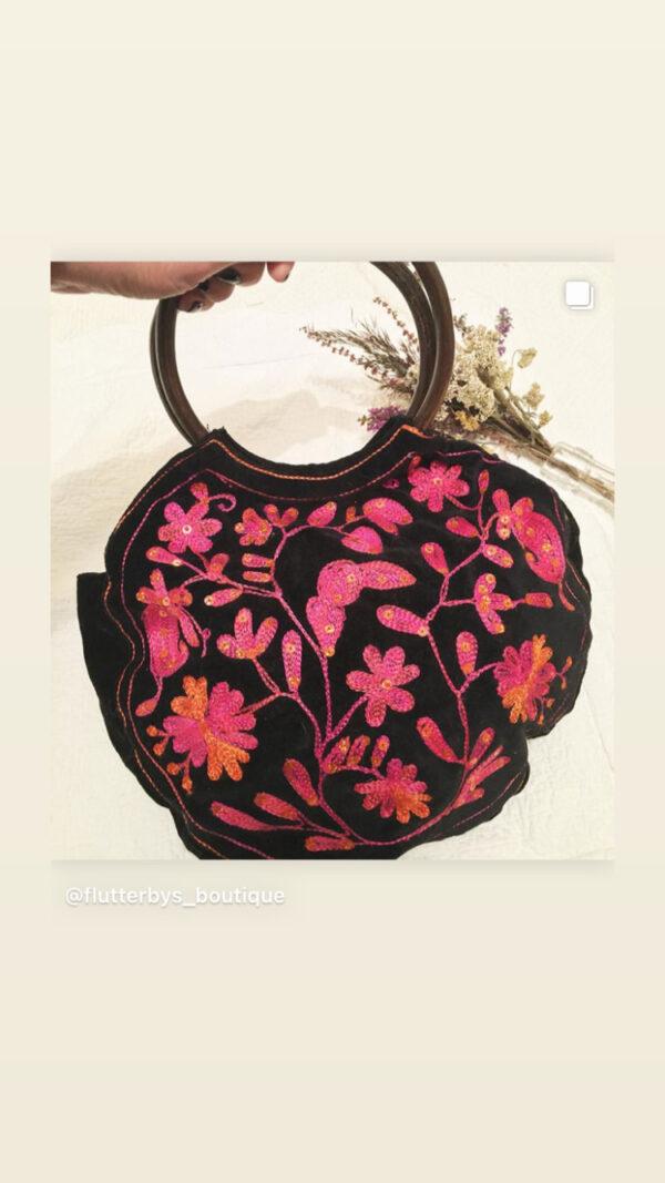 Black velvet Indian bag with pink/orange embroidery and sequins, wooden hoop handles